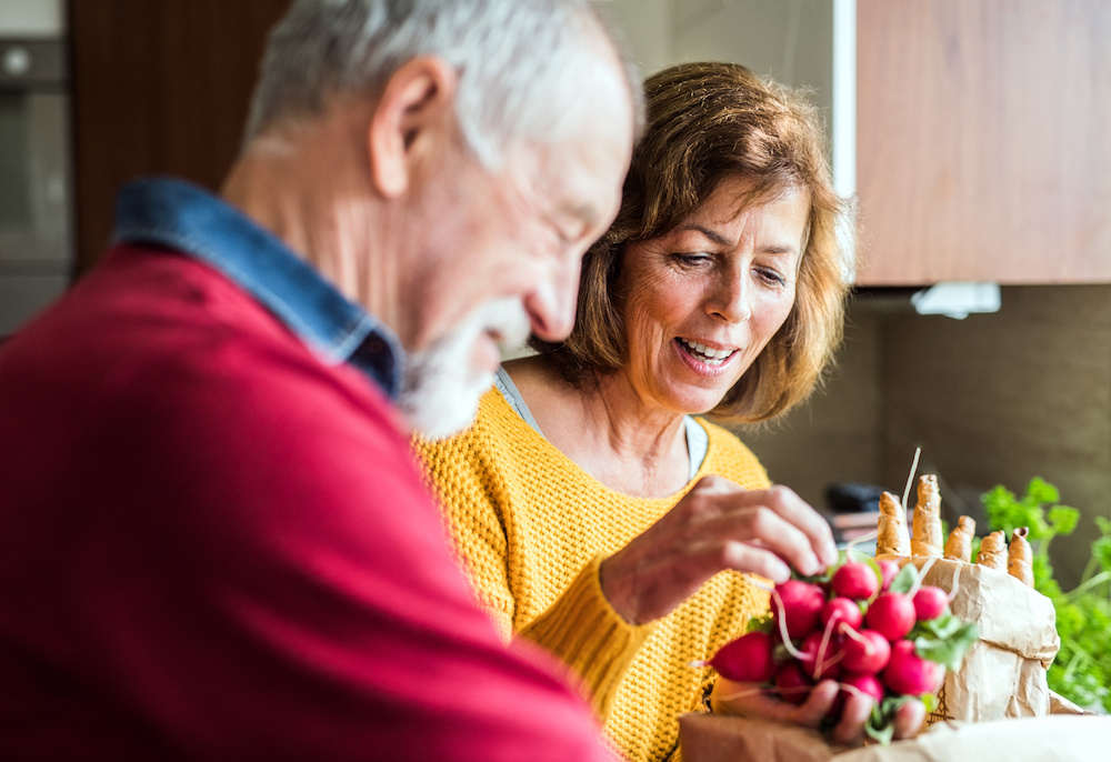 Making healthy choices during cancer treatment | Anova Cancer Care | Couple preparing fresh food