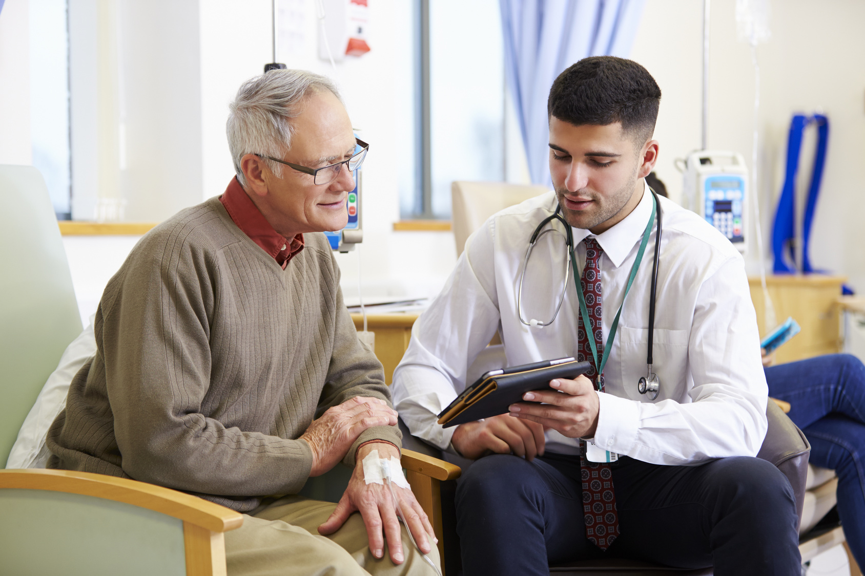 Man and his doctor discussing cancer facts | Anova Cancer Care | Denver